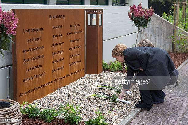 German Chancellor Angela Merkel lays flowers at a memorial for the Germanwings plane crash victims including children and teachers from the...