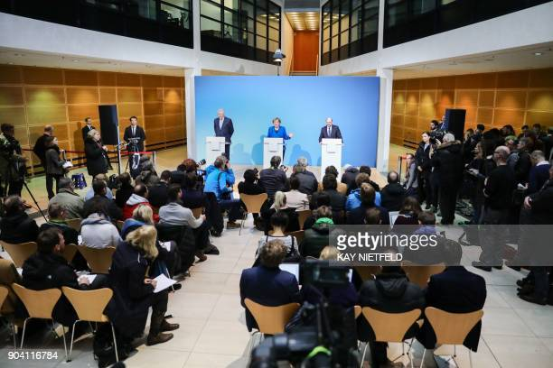 German Chancellor Angela Merkel leader of Germany's conservative CDU party Horst Seehofer leader of the CDU's Bavarian CSU sister party and Martin...
