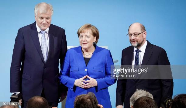 TOPSHOT German Chancellor Angela Merkel leader of Germany's conservative CDU party Horst Seehofer leader of the CDU's Bavarian CSU sister party and...