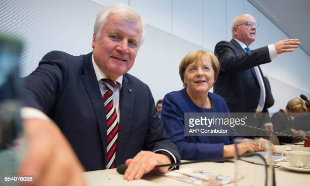 German Chancellor Angela Merkel leader of the conservative Christian Democratic Union has taken seat between Horst Seehofer leader of the CDU's...