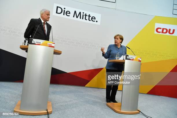 German Chancellor Angela Merkel leader of the conservative Christian Democratic Union and Horst Seehofer leader of the CDU's Bavarian sister party...