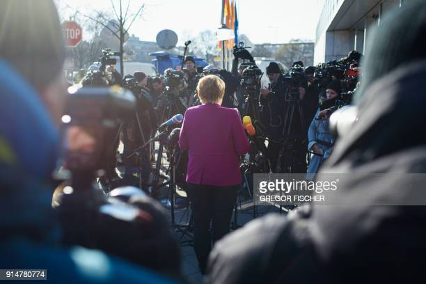 German Chancellor Angela Merkel, leader of the conservative Christian Democratic Union , gives a statement as she arrives for further talks to form a...