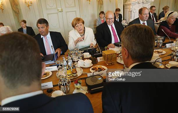 German Chancellor Angela Merkel leads a meeting of the German government cabinet together with European Commissioner for Digital Economy and Society...