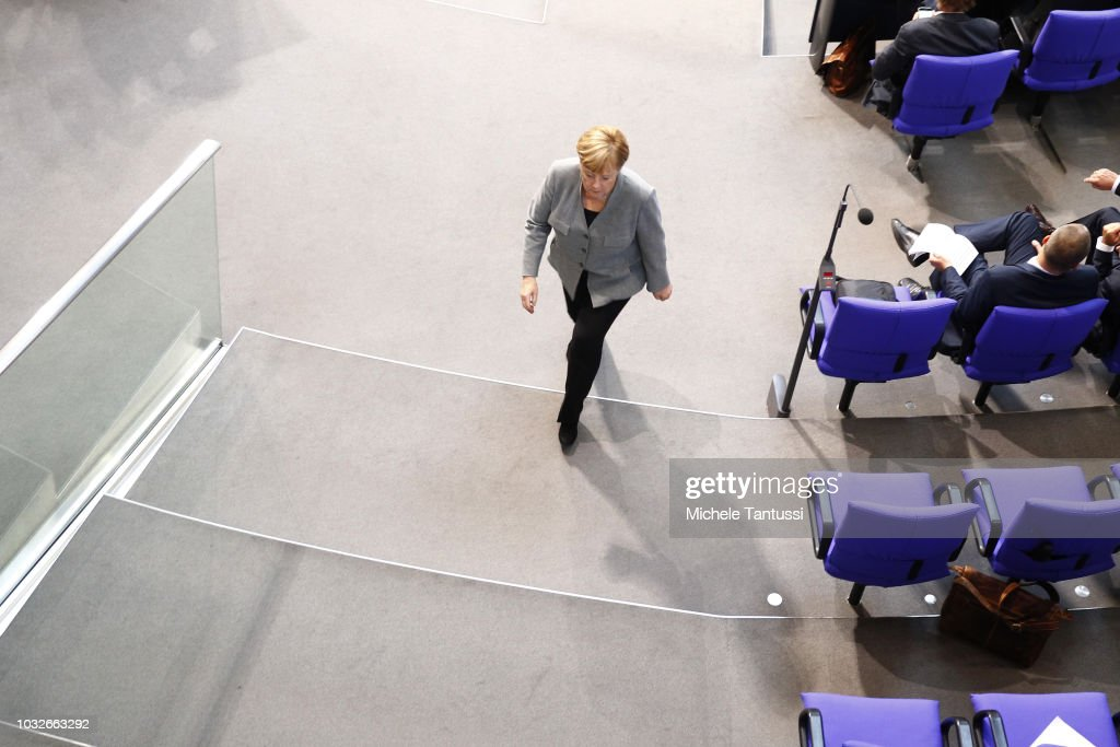 German Chancellor Angela Merkel (CDU) leaves a session of the German Parliament or Bundestag on September 13, 2018 in Berlin, Germany. Relations within the governing German coalition have once again become strained, this time due to comments made by German Interior Minister and Bavarian Christian Social Union leader Horst Seehofer following the recent murder of a German by refugees and the ensuing marches by right-wing supporters in the city of Chemnitz.