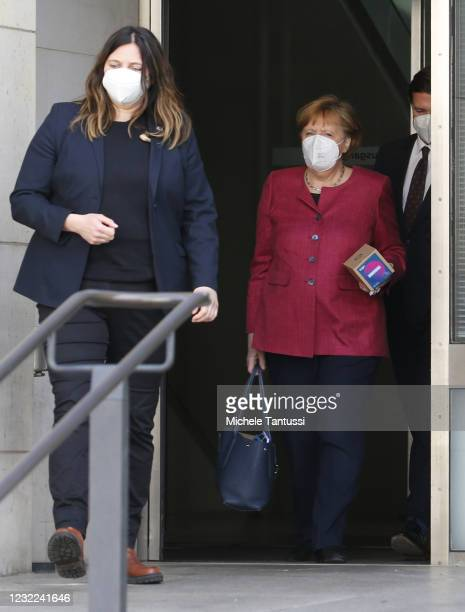 German Chancellor Angela Merkel leaves after a meeting of the CDU/CSU Bundestag faction with party heads Armin Laschet of the CDU and Markus Soeder...