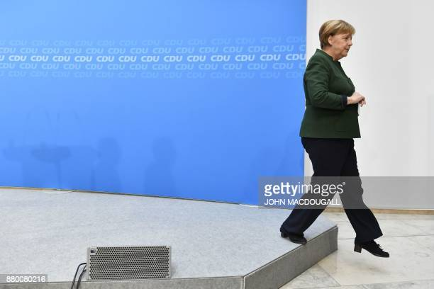TOPSHOT German Chancellor Angela Merkel leaves after giving a press conference on November 27 2017 in Berlin following a meeting with her...