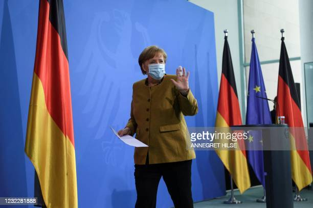 German Chancellor Angela Merkel leaves after giving a statement in Berlin, on April 13, 2021 amid the novel coronavirus COVID-19 pandemic.