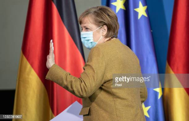 German Chancellor Angela Merkel leaves after giving a statement on the latest coronavirus measures after a Cabinet Meeting on April 13, 2021 in...