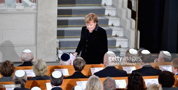 German Chancellor Angela Merkel leaves after speaking during a ceremony at the Synagogue Rykestrasse in Berlin on November 9 2018 to commemorate the...