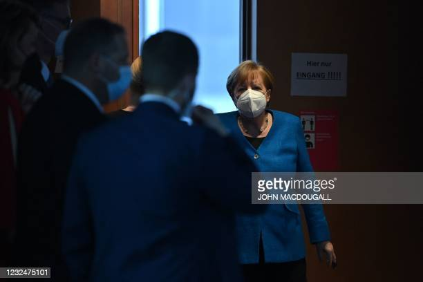 German Chancellor Angela Merkel leaves after testifying in front of a parliamentary committee of inquiry investigating the financial scandal over...