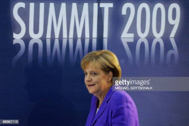 German Chancellor Angela Merkel leaves her final press confrence during the Group of Eight summit in L'Aquila central Italy on July 10 2009 G8...