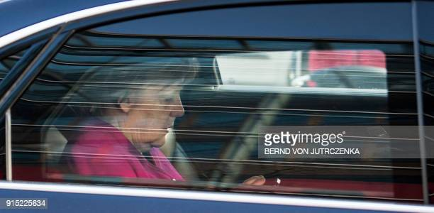German Chancellor Angela Merkel leaves the headquarters of her conservative Christian Democratic Union in Berlin on February 7 after conservatives...