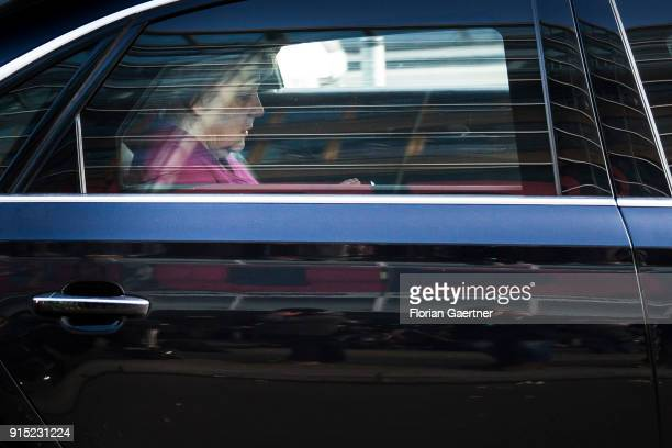 German Chancellor Angela Merkel leaves the party headquarters of the CDU during the coalition negotiations on February 07 2018 in Berlin Germany The...