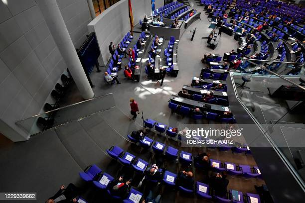 German Chancellor Angela Merkel leaves the plenary hall during a session at the Bundestag on October 29, 2020 in Berlin. - German Chancellor Angela...