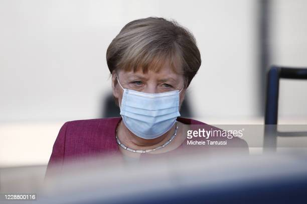 German Chancellor Angela Merkel leaves the plenary room of the germans lower house of Parliament or Bundestag after she spoke on budget law on...