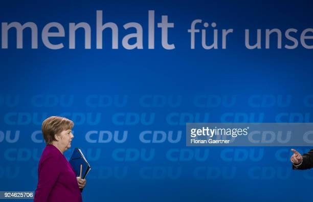 German Chancellor Angela Merkel leaves the stage at the 30th German Christian Democrats party congress on February 26 2018 in Berlin Germany The CDU...