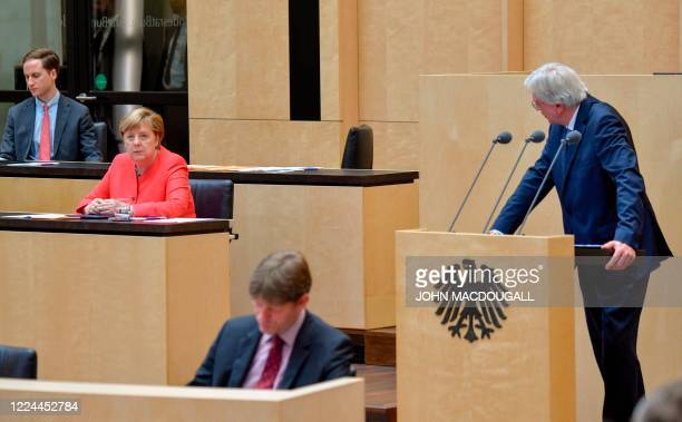 German Chancellor Angela Merkel listens as Hesse's State Premier and Deputy Chairman of the Christian Democratic Union Volker Bouffier delivers a...
