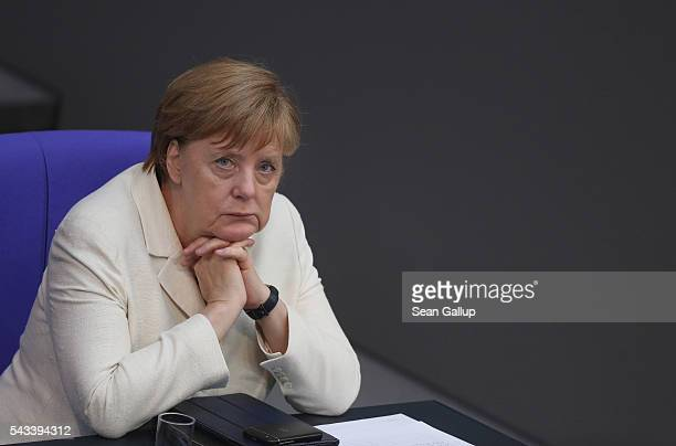 German Chancellor Angela Merkel listens to debates after she addressed the Bundestag with a government declaration on the recent Brexit vote on June...