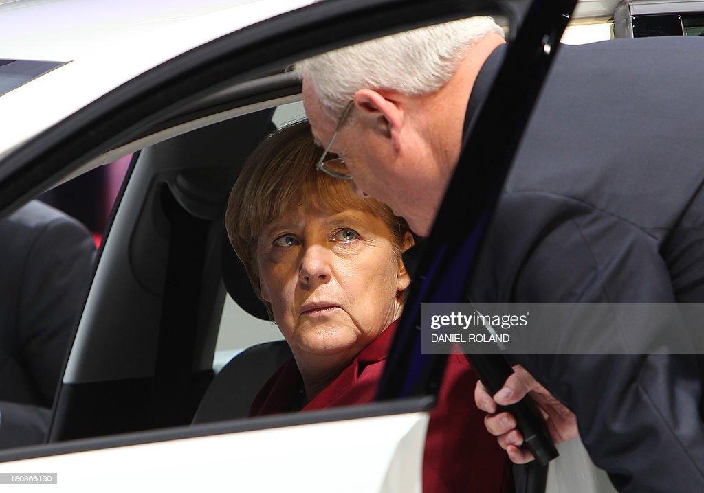 GERMANY-AUTOMOBILE-ECONOMY-FAIR-IAA-OPENING-MERKEL : News Photo