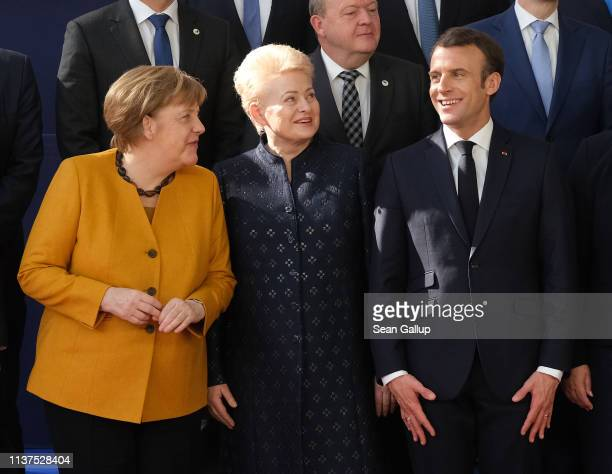 German Chancellor Angela Merkel , Lithuanian President Dalia Grybauskaite and French President Emmanuel Macron chat at the family photo during a...