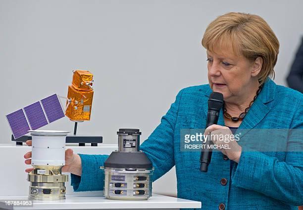 German Chancellor Angela Merkel looks at Autonomous Star Sensors that are flight proven sensor autonomous star tracking systems for longterm GEO and...