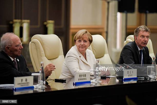 German Chancellor Angela Merkel looks on after her meeting with Chinese President Xi Jinping at their meeting at the West Lake State House in...