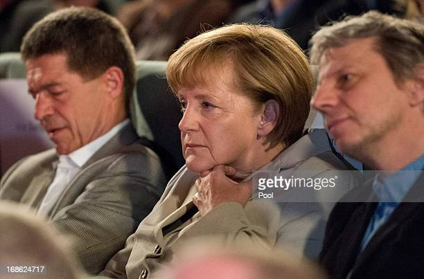 "German Chancellor Angela Merkel looks on as she attends the screening of the 1973 film ""Die Legende von Paul und Paula"" at the Filmkunst 66 cinema on..."