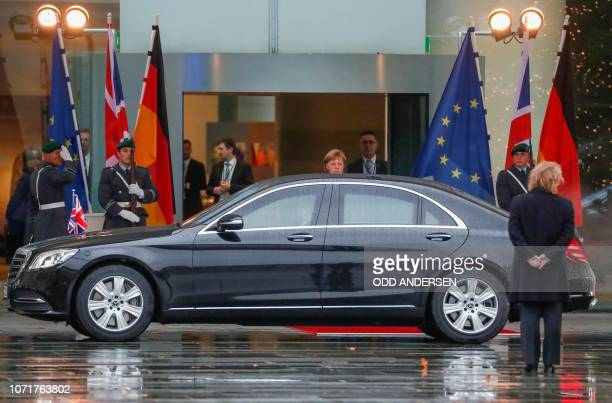 German Chancellor Angela Merkel looks on as the car with British Prime Minister Theresa May is about to leave the courtyard of the Chancellery in...