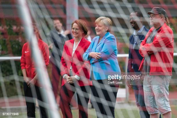 German Chancellor Angela Merkel looks on as young girls train during a program to encourage integration of children with foreign roots through...