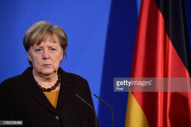 German Chancellor Angela Merkel looks on during a joint press conference with German Health Minister Jens Spahn at the chancellery on March 30, 2021...