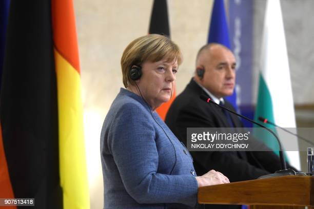 German Chancellor Angela Merkel looks on during a joint press conference with Bulgarian Prime Minister Boyko Borisov in Sofia on January 20 2018 /...