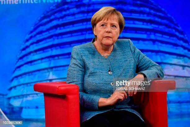 German Chancellor Angela Merkel looks on during her traditional summer interview at a TV studio of German public broadcaster ARD on August 26 2018 in...