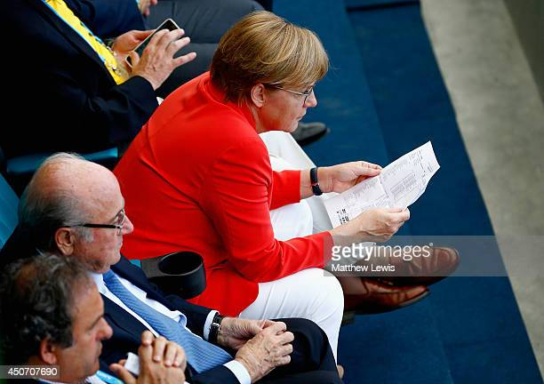 German Chancellor Angela Merkel looks on during the 2014 FIFA World Cup Brazil Group G match between Germany and Portugal at Arena Fonte Nova on June...