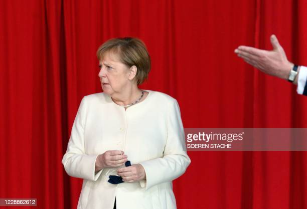 German Chancellor Angela Merkel looks on following celebrations marking the 30th anniversary of the German Reunification at the Metropolis Halle in...