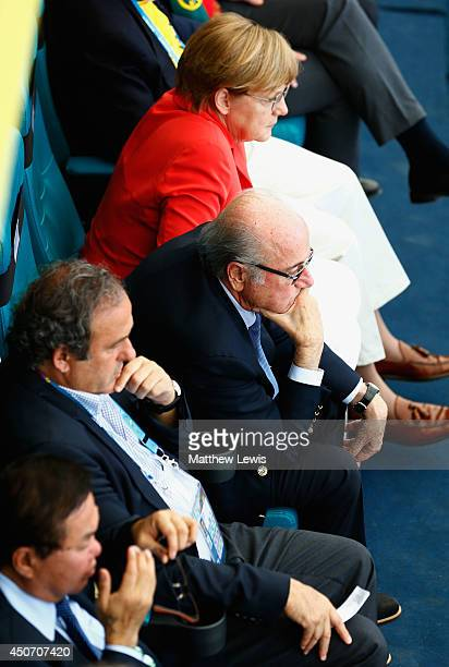 German Chancellor Angela Merkel looks on from the stands during the 2014 FIFA World Cup Brazil Group G match between Germany and Portugal at Arena...