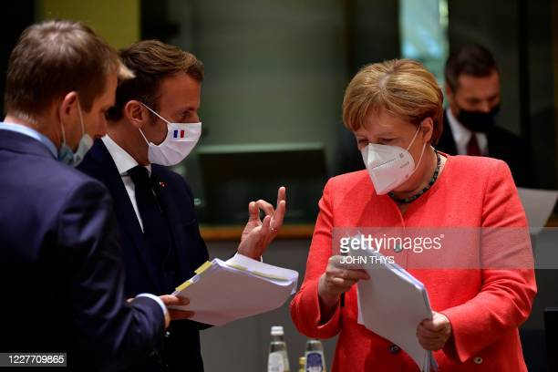 German Chancellor Angela Merkel looks on next to French President Emmanuel Macron during an EU summit in Brussels on July 20 as the leaders of the...