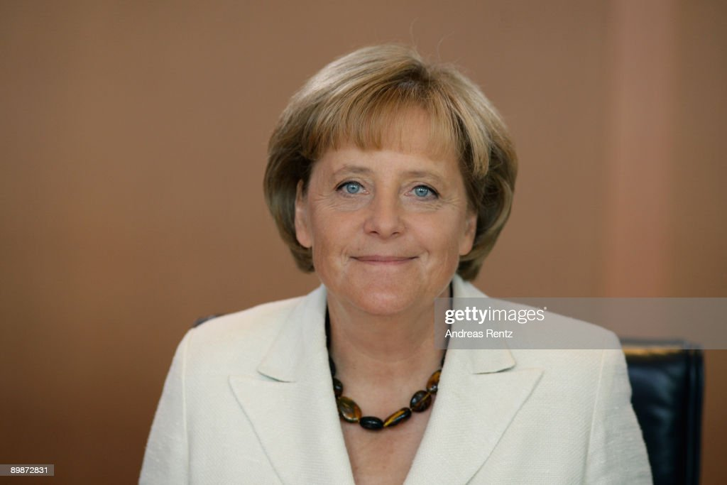 German Chancellor Angela Merkel looks on prior to the weekly German government cabinet meeting at the Chancellery on August 19, 2009 in Berlin, Germany. High on the morning's agenda was the obligation of the statutory health insurance of the new vaccinations against influenza A(H1N1), so called swine flu.
