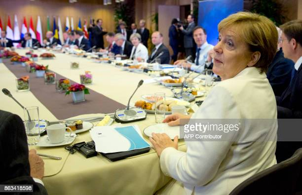 German Chancellor Angela Merkel looks over as she joins other EU leaders for a breakfast meeting during an EU summit in Brussels on October 20 2017...