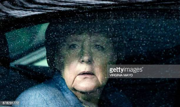 TOPSHOT German Chancellor Angela Merkel looks through raindrops on her car window as she arrives for an EU Eastern Partnership summit with six...