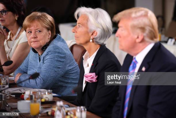 German Chancellor Angela Merkel looks towards US President Donald Trump during the Gender Equality Advisory Council working breakfast on the second...