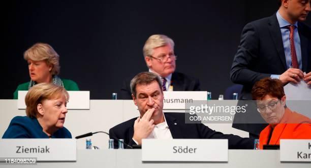 German Chancellor Angela Merkel, Markus Soeder, leader of the conservative Christian Social Union , and the leader of the Christian Democratic Union...