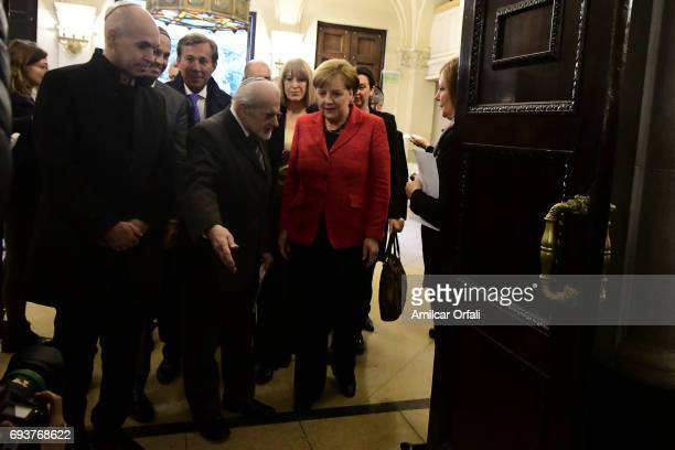 German Chancellor Angela Merkel Mayor of Buenos Aires Horacio Rodriguez Larreta and Rabbi Simon Moguilevsky walk into the Templo Libertad prior the...