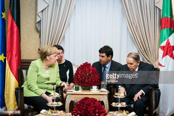 German Chancellor Angela Merkel meets Algerian President Abdelaziz Bouteflika for a bilateral discussion on September 17 2018 in Algiers Algeria