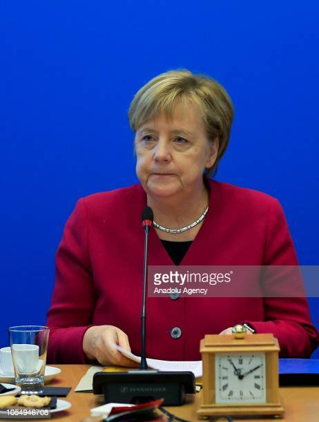 German Chancellor Angela Merkel meets Hessen's State Premier Volker Bouffier at the Christian Democratic Union Headquarters after the Hessian state...