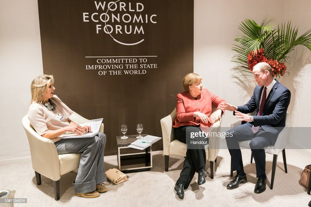 German Chancellor Angela Merkel meets Prince William And Queen Maxima of the Netherlands In Davos : News Photo
