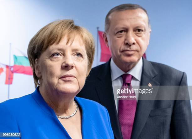 German Chancellor Angela Merkel meets Turkish President Recep Tayyip Erdogan on the first day of the North Atlantic Treaty Organization summit in...