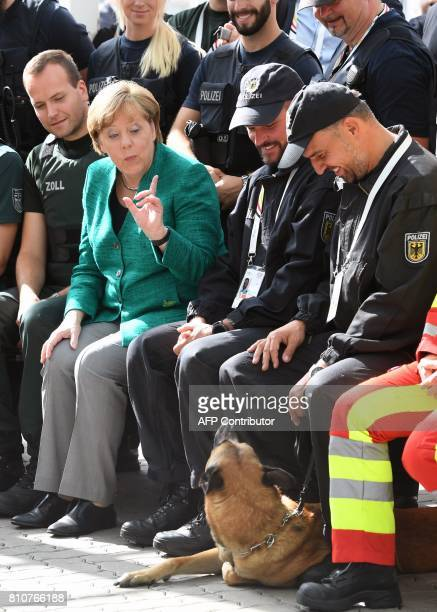 German Chancellor Angela Merkel meets with police after the G20 Summit in Hamburg Germany July 8 2017 / AFP PHOTO / Patrik STOLLARZ