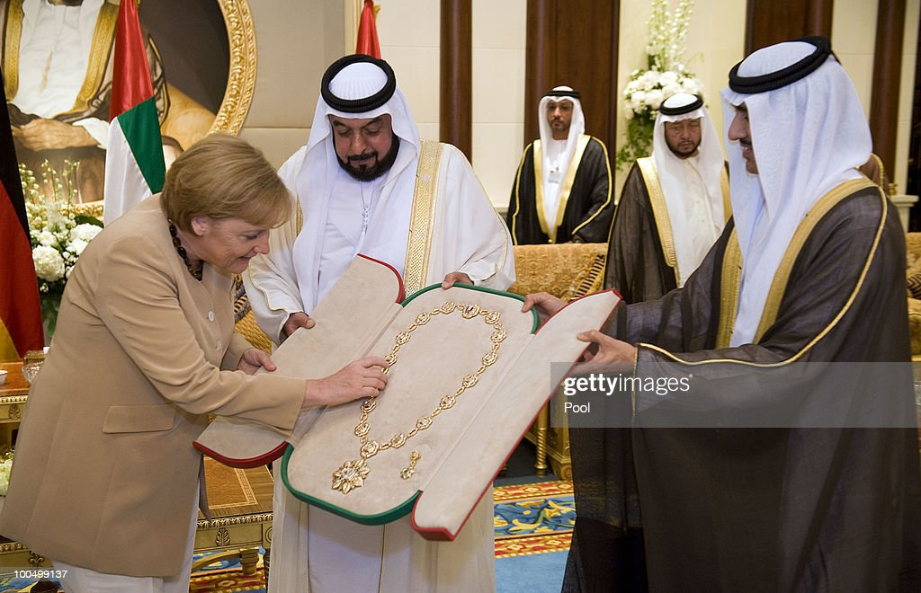 German Chancellor Angela Merkel meets with United Arab Emirates President Sheikh Khalifa bin Zayed Al Nahyanis and is honoured with the highest award of the country, the Sheikh-Zayed medal on May 25, 2010 in Abu Dhabi, United Arab Emirates. Merkel began her four-day tour of the Gulf region in the United Arab Emirates on May 24 to promote the Middle East peace process. Political talks in the United Arab Emirates, Bahrain, Qatar and Saudi Arabia will also be dominated by regional security issues and the nuclear standoff with Iran.