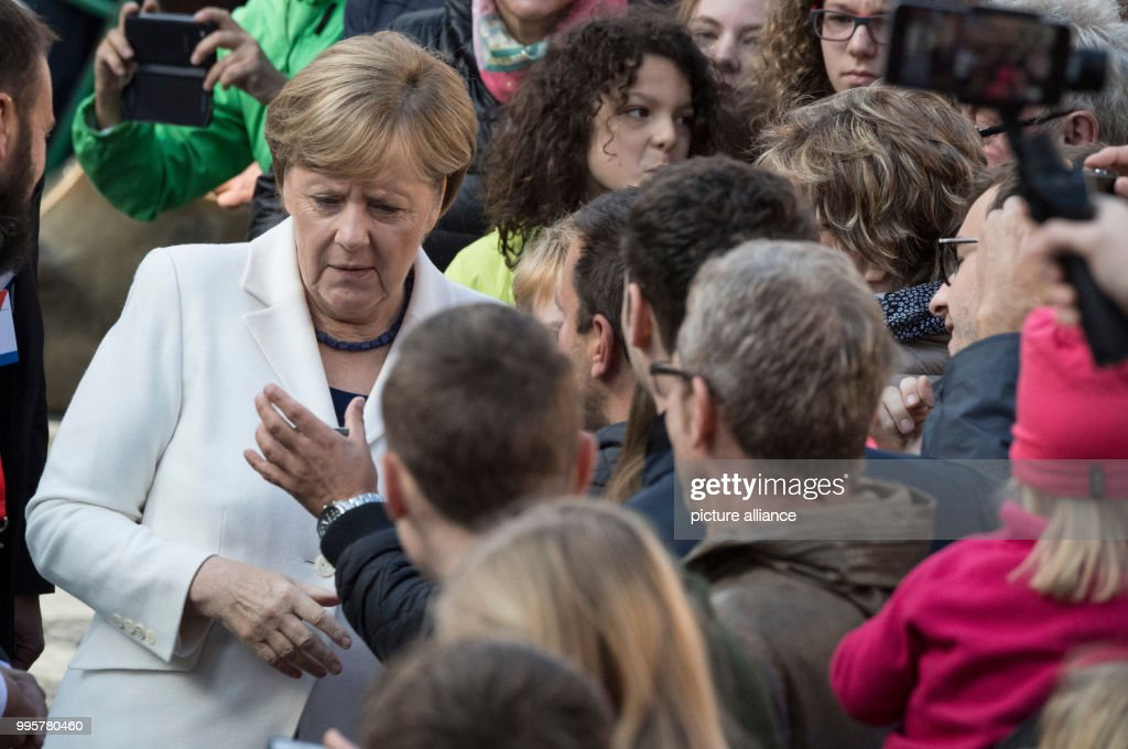 german chancellor angela merkel mingles in the crowd during the