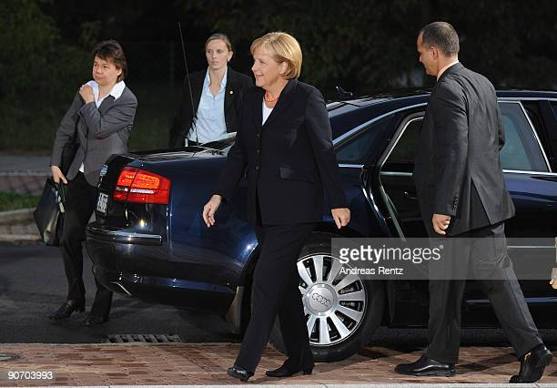 German Chancellor Angela Merkel of the Christian Democratic Union and her personal assistant Beate Baumann arrive at Studio Berlin for the debate...